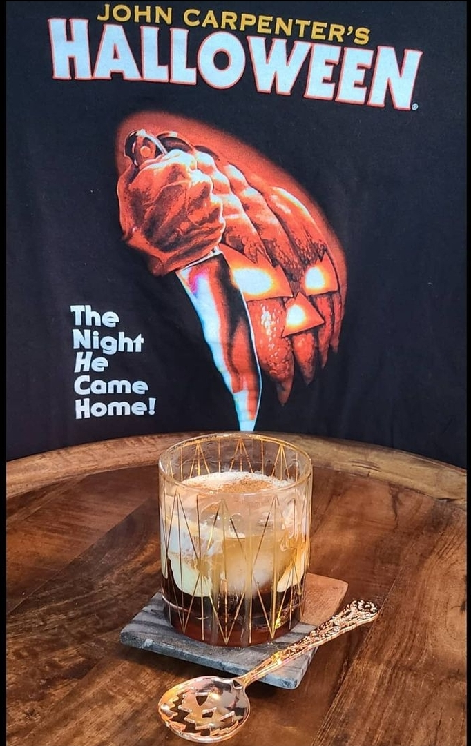 Pumpkin White Russian by Join_Jules in front of Halloween T-Shirt with pumpkin spoon on display