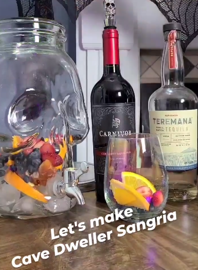 Ingredients to make Cave Dweller Sangria on display including Carnivor Red Wine and Teremana Tequila