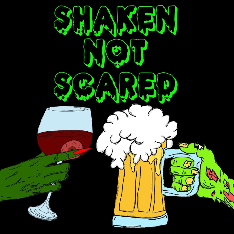 The Shaken Not Scared Podcast logo. A green witch hand holding a glass of red wine with an eye ball in it on the left and a green ripped zombie hand holding a glass of beer on the right.